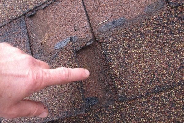 Cover a wide area of the roof with plastic if it is safe to get on the roof