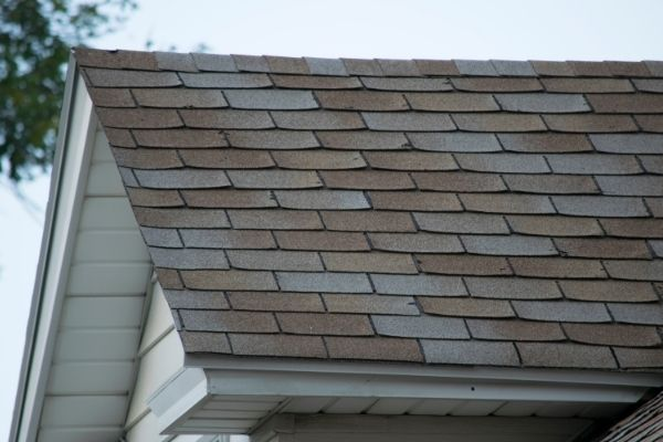 Frozen water can move under loose shingles, refreeze, and expand again when the ice thaws